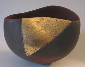 7. Asymmetrical bowl w gold