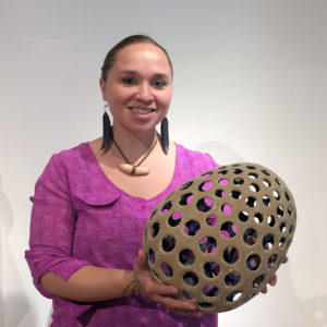 "Courtney M. Leonard holding one of her clay pieces from the ""Breach"" Series, 2016, King Galleries, Scottsdale."