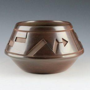 Roller, Jordan – Brown Bowl with Walking Bear Paw Design